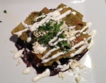 ChilaquilesCorn tortillas, chorizo, queso cotija, soft scrambled eggs, and salsa verde
