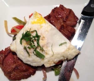 Adobo-Marinated Flank SteakRoasted peppers, fried egg, black beans