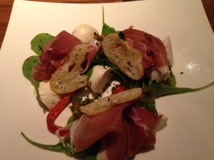 House Made Mozzarella with Marinated Heirloom Hot & Sweet Peppers baby arugula, shaved prosciutto, garlic crisp, olive oil