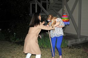 There were also 2 pinatas for party entertainment - one filled with candy and another filled with small bottles of liquor. Here I am spinning Katie around before she starts swinging.