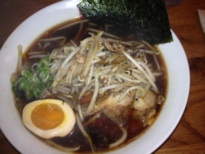 A very dark, rich soy sauce is used in this ramen, along with roasted garlic and caramel tones.