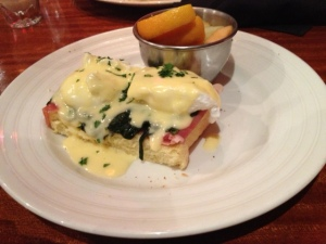 Poached Eggs Benedict Served with Toasted Brioche, Sautéed Baby Spinach, Prosciutto & Hollandaise. Side of Fruit.