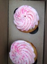Two Princess cupcakes. (Vanilla cupcake with strawberry icing!)