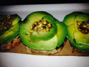 Avocado, pistachios, toasted pistachio oil, sea salt, grilled bread.