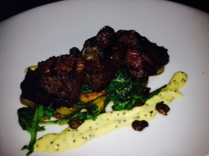 Grilled Hangar Steak, roasted fingerlings, mustard greens, salsa verde.