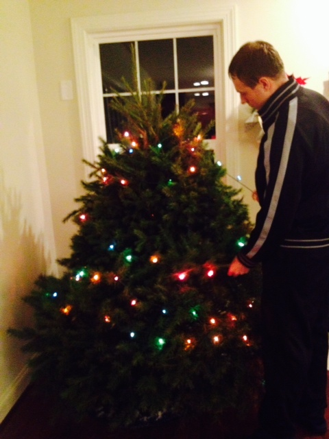 Decorating our tree on Monday night!