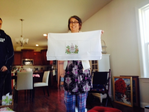 Mom with one of her presents on Christmas morning. (A Capitol Cherry Blossom dish towel).