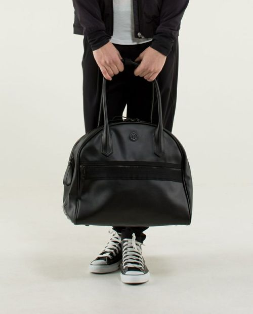 This bag (or something like it) looks big enough to do the job and easier to carry around.