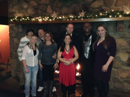 Entire group photo in front of the beautiful and huge fireplace in the restaurant.