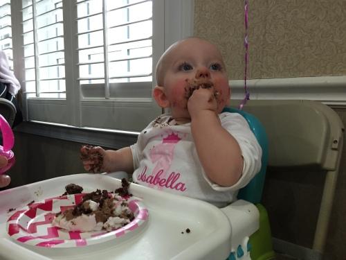 The birthday gal loving her cake.