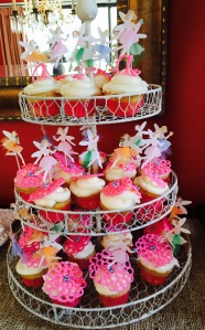 My friend Christina's famous Coconut Cupcakes with handmade flower toppers and Fairy toppers.